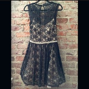 Black and cream lace overlay dress. Worn once!
